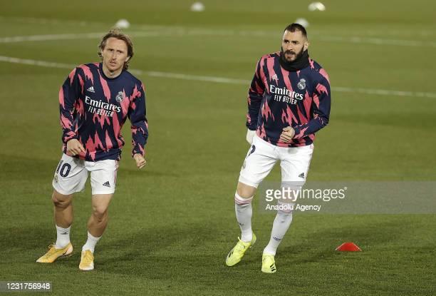 Karim Benzema and Luka Modric of Real Madrid warm up ahead of the UEFA Champions League Round of 16 match between Real Madrid and Atalanta at Alfredo...