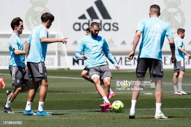 Karim Benzema and Álvaro Odriozola both of Real Madrid are training with teammate Federico Valverde at Valdebebas training ground on May 19, 2021 in...