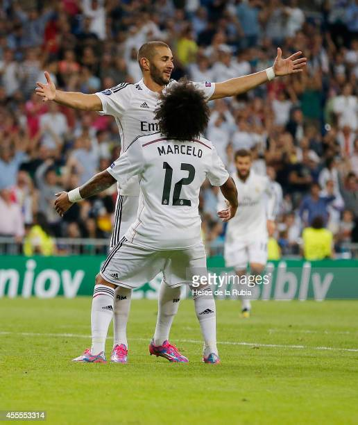 Karim Benzema and Marcelo of Real Madrid celebrate after scoring during the UEFA Champions League group B match between Real Madrid and FC Basel 1893...