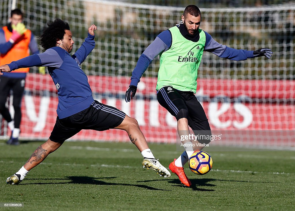 Karim Benzema (R) and Marcelo of Real Madrid during a training session at Valdebebas training ground on January 6, 2017 in Madrid, Spain.