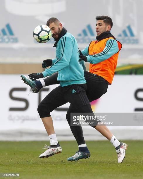 Karim Benzema and Marco Asensio of Real Madrid in action during a training session at Valdebebas training ground on March 2 2018 in Madrid Spain