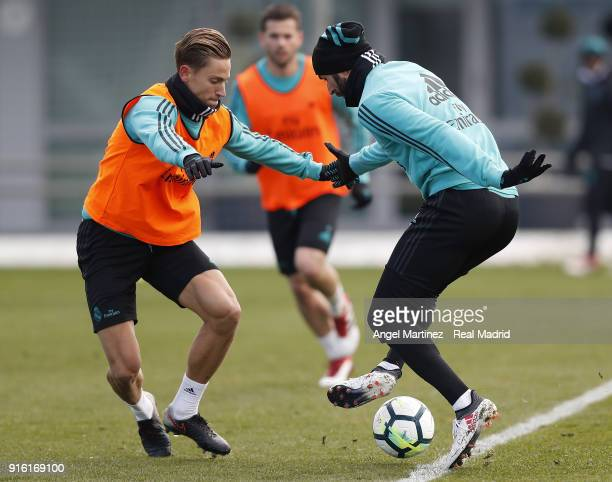 Karim Benzema and Marcos Llorente of Real Madrid in action during a training session at Valdebebas training ground on February 9 2018 in Madrid Spain