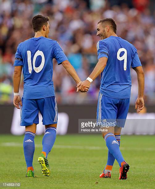 Karim Benzema and Mesut Ozil of Real Madrid celebrate after scoring during the friendly match between Paris SaintGermain and Real Madrid at Gamla...