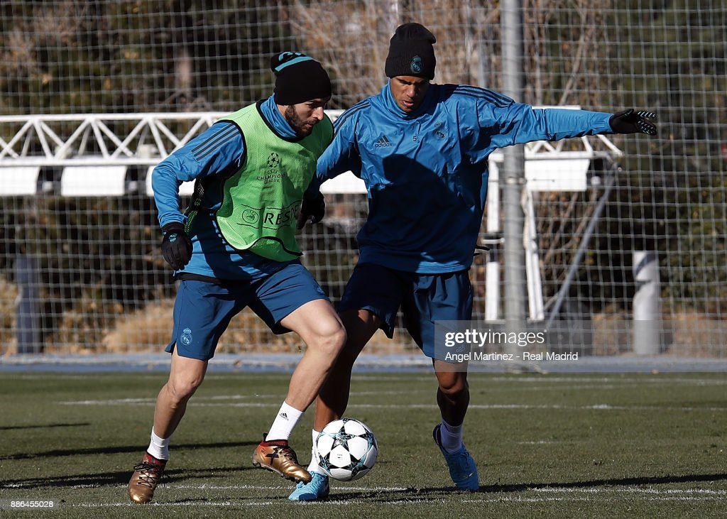 Karim Benzema (L) and Raphael Varane of Real Madrid in action during a training session at Valdebebas training ground on December 5, 2017 in Madrid, Spain.