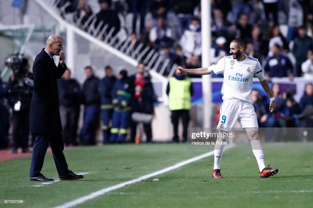 Karim Benzema and Zinedine Zidane of Real Madrid CF celebrate after scoring during the UEFA Champions League group H match between APOEL Nikosia and Real Madrid at GSP Stadium on November 21, 2017 in Nicosia, Cyprus.