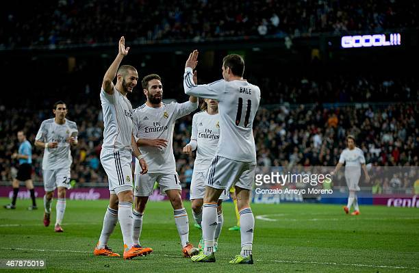 Karim Benzema celebrates scoring their second goal with teammates Daniel Carvajal and Gareth Bale during the La Liga match between Real Madrid CF and...