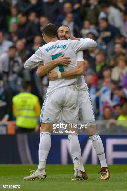 Karim Benzema celebrates with Cristiano Ronaldo Real Madrid after scoring the first goal of his team during a match between Real Madrid and Malaga as...