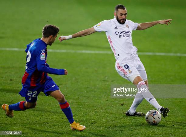Karim Benzema controlling the ball in front of Alejandor Pozo during the La Liga Santander match between SD Eibar and Real Madrid at Estadio...