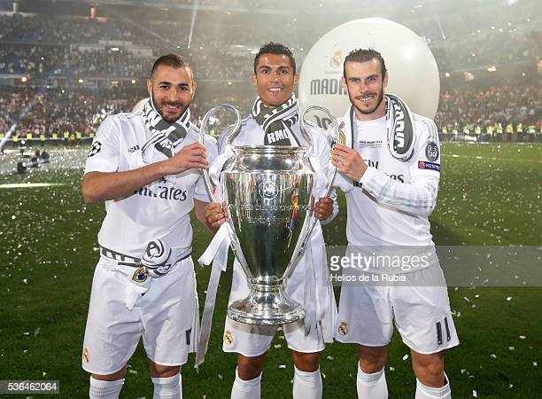 Karim Benzema, Cristiano Ronaldo and Gareth Bale of Real Madrid CF during Real Madrid CF team celebration at Santiago Bernabeu Stadium the day after...
