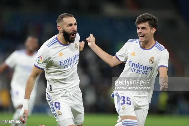Karim Benzema le of Real Madrid CF celebrates scoring their opening goal with teammate Miguel Gutierrez during the La Liga Santander match between...