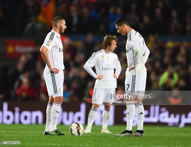 Karim Benzema, Luka Modric and Cristiano Ronaldo of Real Madrid CF look dejected as Luis Suarez of Barcelona scores their second goal during the La...