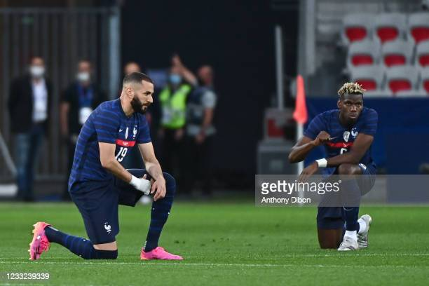 Karim BENZEMA of France and Paul POGBA of France knees during the international team friendly match between France and Wales at Allianz Riviera on...