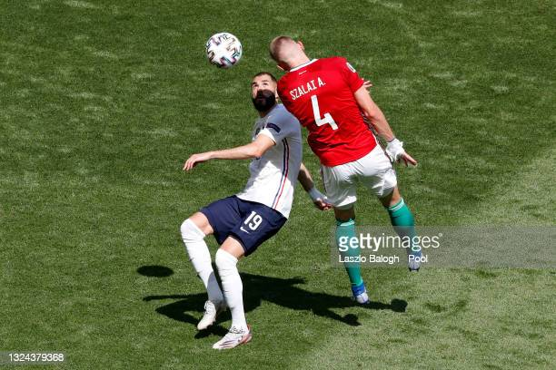 Karim Benzema of France battles for possession with Attila Szalai of Hungary during the UEFA Euro 2020 Championship Group F match between Hungary and...