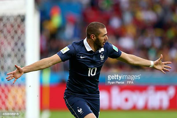 Karim Benzema of France celebrates after his shot went in off Noel Valladares of Honduras to score a goal during the 2014 FIFA World Cup Brazil Group...