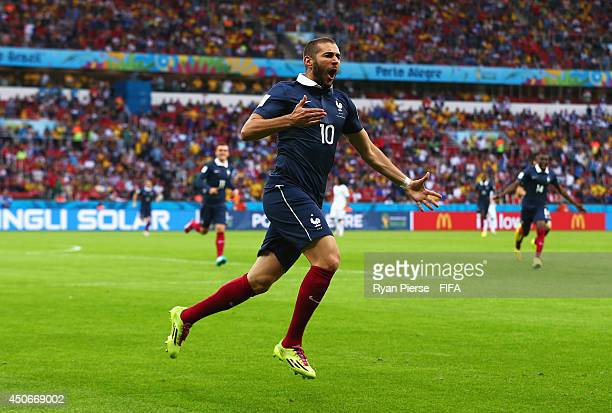 Karim Benzema of France celebrates after his shot went in off Noel Valladares of Honduras to score an own goal during the 2014 FIFA World Cup Brazil...