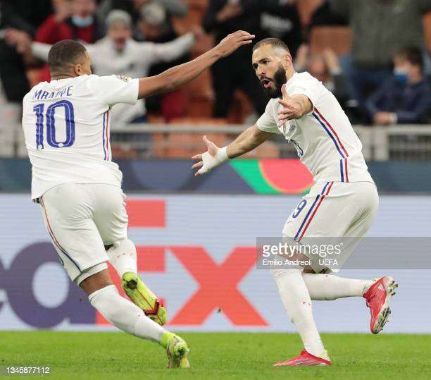 Karim Benzema of France celebrates after scoring their sides first goal with team mate Kylian Mbappe during the UEFA Nations League 2021 Final match...