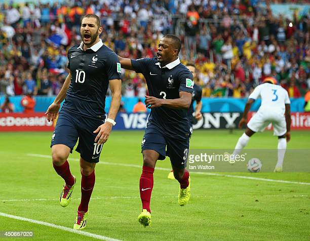 Karim Benzema of France celebrates scoring his team's first goal on a penalty kick with Patrice Evra during the 2014 FIFA World Cup Brazil Group E...