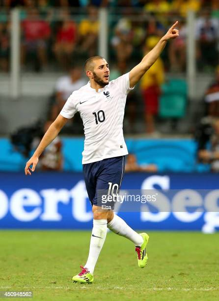 Karim Benzema of France celebrates scoring his team's fourth goal during the 2014 FIFA World Cup Brazil Group E match between Switzerland and France...