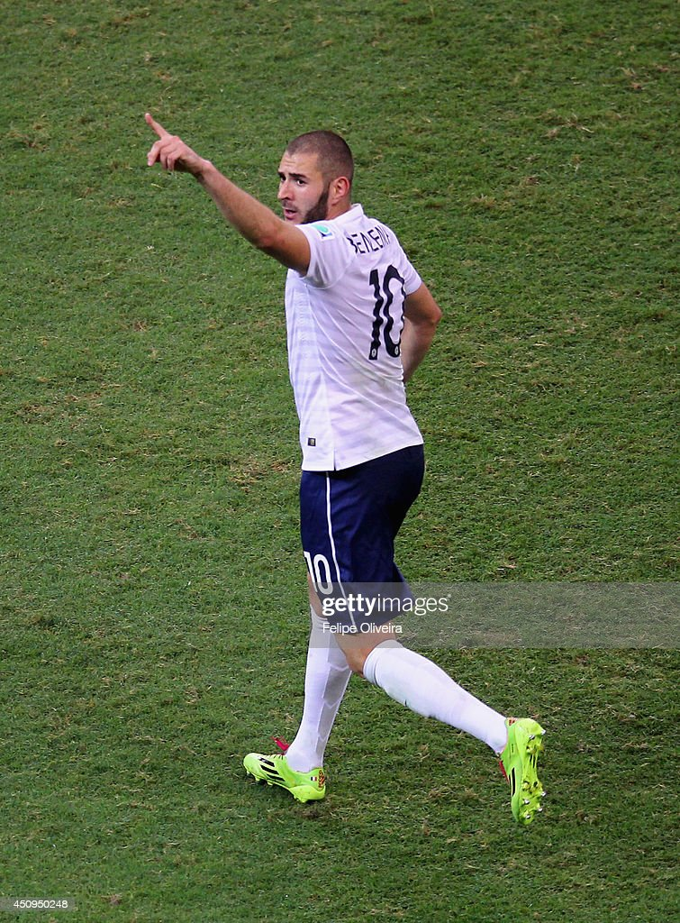 Karim Benzema of France celebrates scoring his team's fourth goal during the 2014 FIFA World Cup Brazil Group E match between Switzerland and France at Arena Fonte Nova on June 20, 2014 in Salvador, Brazil.