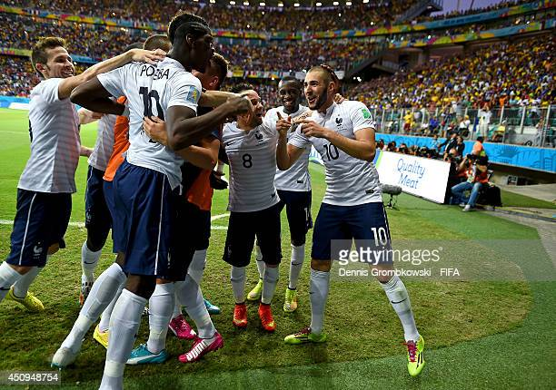 Karim Benzema of France celebrates scoring his team's fourth goal with his teammates during the 2014 FIFA World Cup Brazil Group E match between...