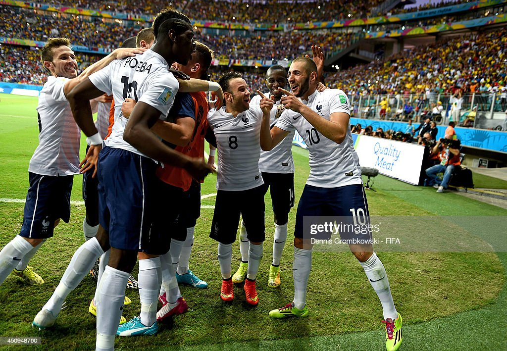 Karim Benzema (1st R) of France celebrates scoring his team's fourth goal with his teammates during the 2014 FIFA World Cup Brazil Group E match between Switzerland and France at Arena Fonte Nova on June 20, 2014 in Salvador, Brazil.