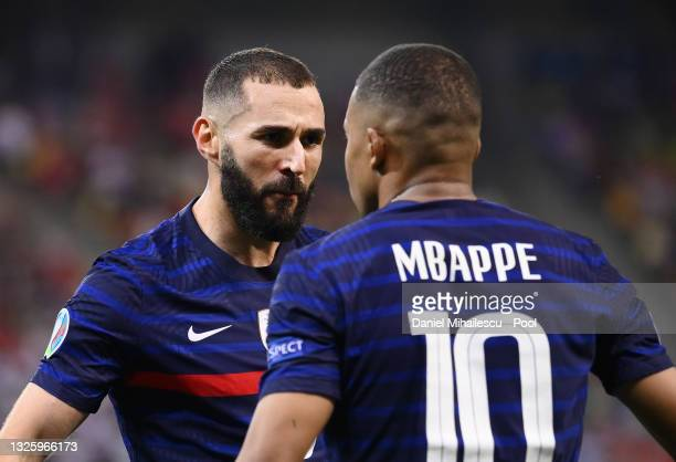 Karim Benzema of France celebrates with Kylian Mbappe after scoring their side's first goal during the UEFA Euro 2020 Championship Round of 16 match...