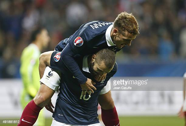 Karim Benzema of France celebrates with teammate Antoine Griezmann scoring the fourth goal for his team during the international friendly match...