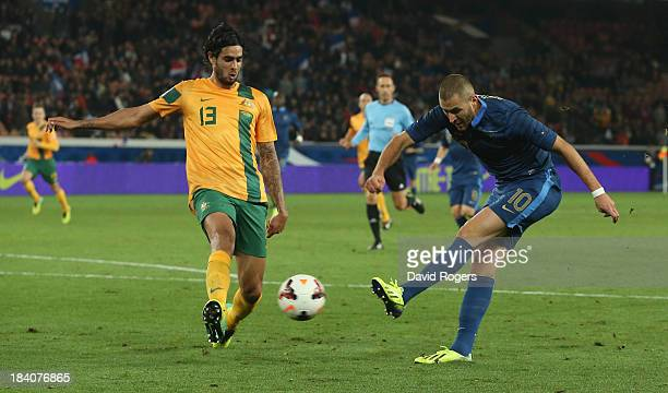 Karim Benzema of France fires a shot past Rhys Williams during the International Friendly match between France and Australia at Parc des Princes on...