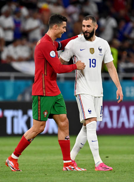 Karim Benzema of France interacts with Cristiano Ronaldo of Portugal during the UEFA Euro 2020 Championship Group F match between Portugal and France...