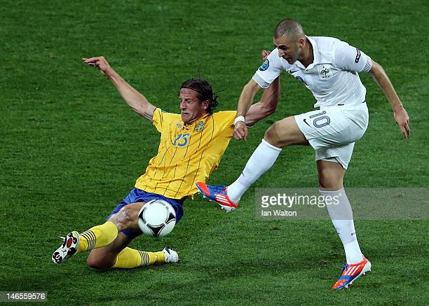 Karim Benzema of France is challenged by Jonas Olsson of Sweden during the UEFA EURO 2012 group D match between Sweden and France at The Olympic...