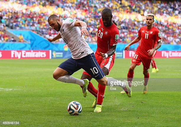 Karim Benzema of France is fouled by Johan Djourou of Switzerland and awarded a penalty kick during the 2014 FIFA World Cup Brazil Group E match...