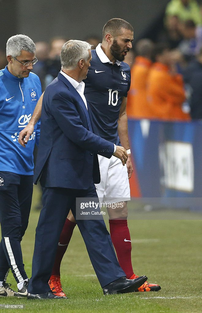 Karim Benzema of France is replaced by head coach of France Didier Deschamps after getting injured during the international friendly match between France and Armenia at Allianz Riviera stadium on October 8, 2015 in Nice, France.