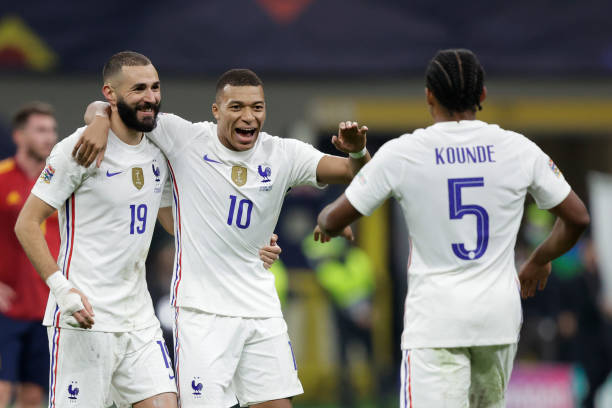 Karim Benzema of France, Kylian Mbappe of France, Jules Kounde of France celebrating the victory during the UEFA Nations league match between Spain v...