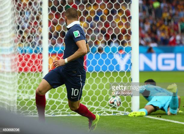 Karim Benzema of France looks back as goalkeeper Noel Valladares of Honduras fails to save France's second goal during the 2014 FIFA World Cup Brazil...