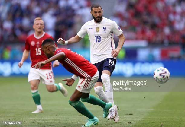 Karim Benzema of France passes the ball whilst under pressure from Loic Nego of Hungary during the UEFA Euro 2020 Championship Group F match between...