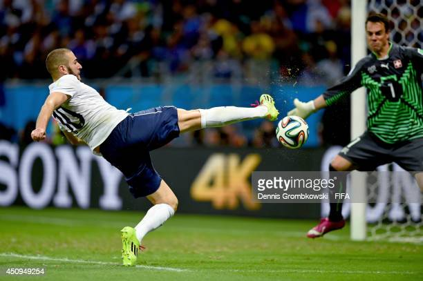 Karim Benzema of France scores his team's fourth goal during the 2014 FIFA World Cup Brazil Group E match between Switzerland and France at Arena...