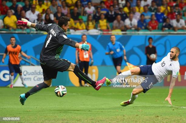 Karim Benzema of France scores his team's fourth goal past Diego Benaglio of Switzerland during the 2014 FIFA World Cup Brazil Group E match between...
