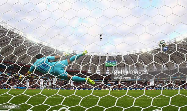 Karim Benzema of France scores the first goal from the penalty spot during the 2014 FIFA World Cup Brazil Group E match between France and Honduras...