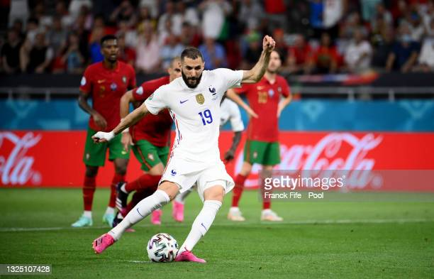 Karim Benzema of France scores their side's first goal from the penalty spot during the UEFA Euro 2020 Championship Group F match between Portugal...