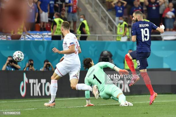 Karim Benzema of France scores their side's first goal past Yann Sommer of Switzerland during the UEFA Euro 2020 Championship Round of 16 match...