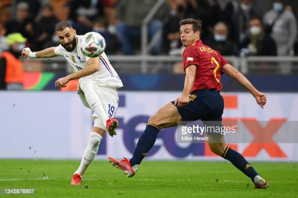 Karim Benzema of France scores their side's first goal whilst under pressure from Cesar Azpilicueta of Spain during the UEFA Nations League 2021...