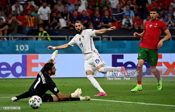 Karim Benzema of France scores their side's second goal past Rui Patricio of Portugal during the UEFA Euro 2020 Championship Group F match between...