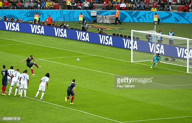 Karim Benzema of France shoots and scores his team's first goal on a penalty kick past Noel Valladares of Honduras during the 2014 FIFA World Cup...