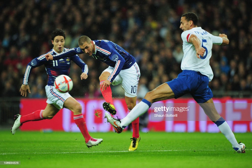 Karim Benzema of France shoots past Rio Ferdinand of England during the international friendly match between England and France at Wembley Stadium on November 17, 2010 in London, England.
