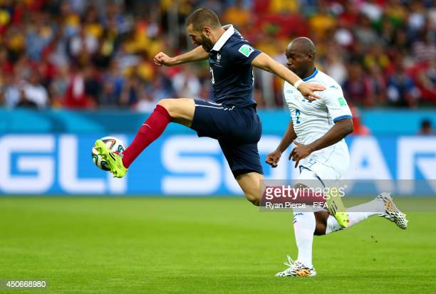 Karim Benzema of France shoots toward goal before Noel Valladares of Honduras handles it over the line to score an own goal during the 2014 FIFA...