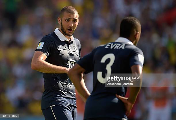 Karim Benzema of France speaks to teammate Patrice Evra during the 2014 FIFA World Cup Brazil Quarter Final match between France and Germany at...