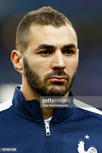 Karim Benzema of France stands for the national anthem prior to the International Friendly match between France and Brazil at the Stade de France on...