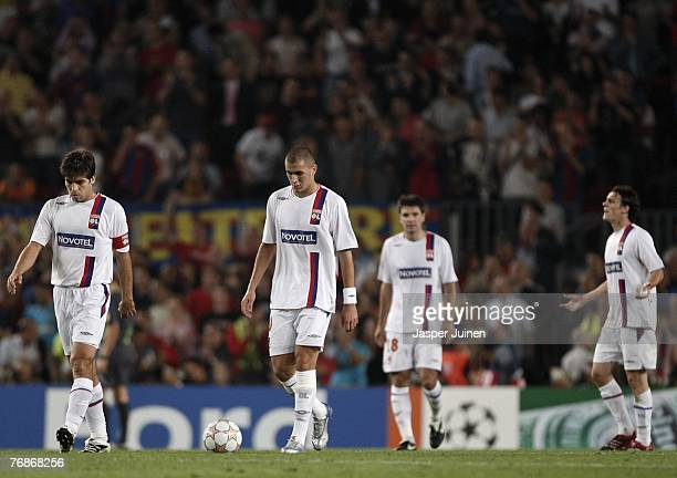 Karim Benzema of Lyon trudges back to the halfway line with his teammates after Barcelona opened the score during the UEFA Champions League Group E...