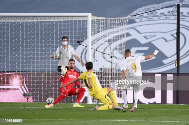 Karim Benzema of Madrid scores the first goal during the Liga match between Real Madrid CF and Villarreal CF at Estadio Alfredo Di Stefano on July...