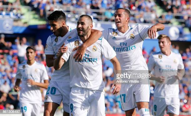 Karim Benzema of Ral Madrid CF celebrates after scoring his teams opening goal during the La Liga match between Getafe and Real Madrid at Coliseum...